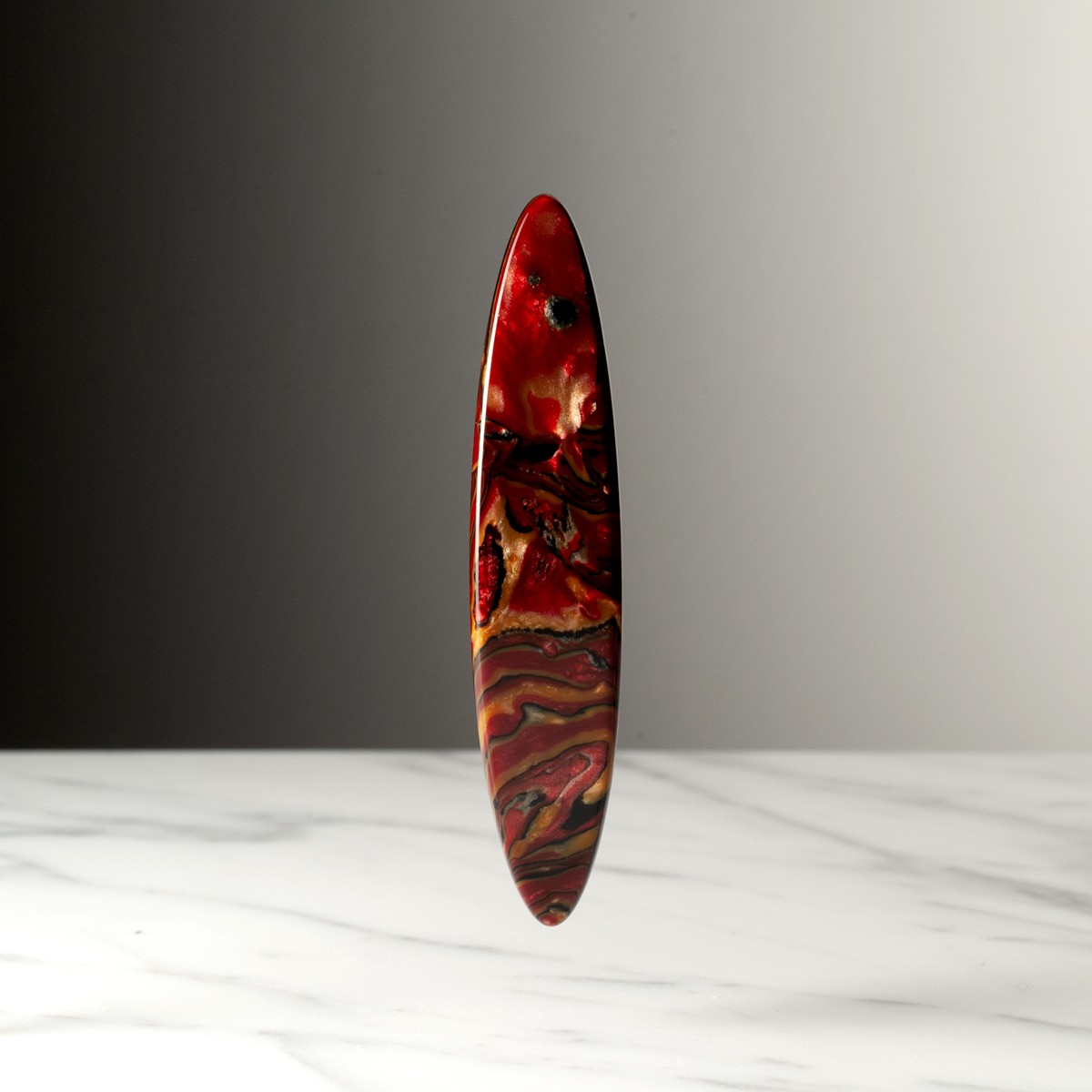 navette-petit-modele-marbre-rouge